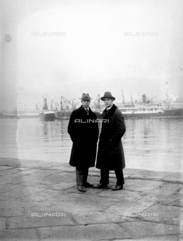 CRA-F-000024-0000 - Full-length portrait of two men. In the background a few ships in the port of Trieste - Date of photography: 19/11/1924 - Alinari Archives-Camerini archive, Florence