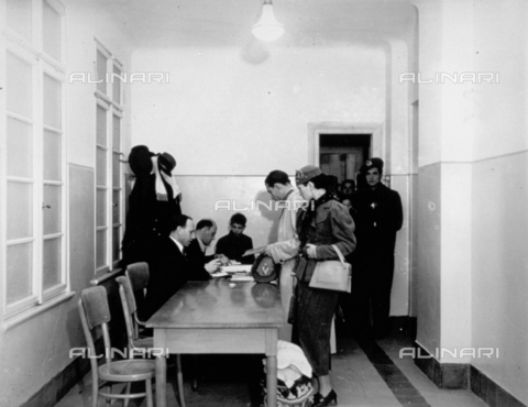CRA-F-000032-0000 - A few officers are controlling the documents and embarkation papers of the emigrants for Palestine - Date of photography: 1922-1930 ca. - Alinari Archives-Camerini archive, Florence