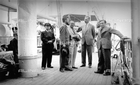 CRA-F-000069-0000 - The Bridge of a ship with a group of emigrants leaving for Palestine. On the right doctor Morpurgo, secretary of the Israelite community in Trieste, can be identified - Date of photography: 1922-1930 - Alinari Archives-Camerini archive, Florence