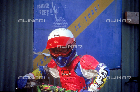 DAL-F-004276-0000 - Photograph showing a motocross racer wearing a helmet and a suit. Suburb of Cerbaia, San Casciano in Val di Pesa, Florence.