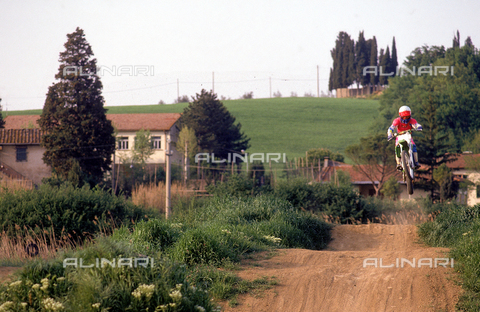 DAL-F-004887-0000 - Stretch of a motocross track and a motorcyclist. Environs of Castelnuovo d'Elsa, Castelfiorentino, Florence.