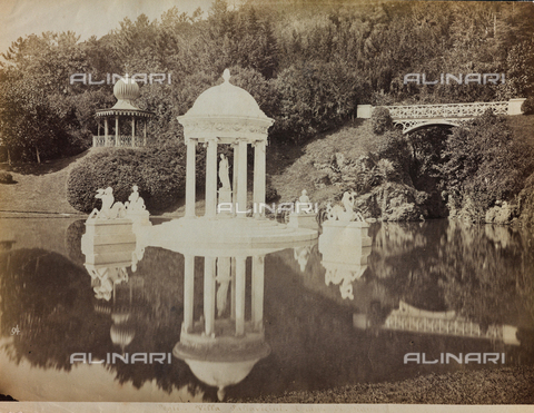 FBQ-F-004390-0000 - Romantic corner of the park of Villa Pallavicini in Pegli. In the foreground the pond with the Temple of Diana at the center. On the right the iron bridge and the artificial cave. In the background, on the left, the exotic pagoda - Data dello scatto: 1870 -1890 - Archivi Alinari, Firenze