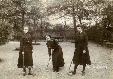 FVQ-F-014079-0000 - Three young women portrayed as playing cricket in the courtyard of a school