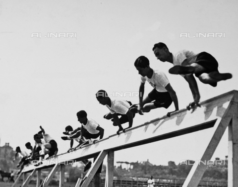 FVQ-F-119125-0000 - Athletes, of the Fascist Academy, portrayed while jumping a hurdle