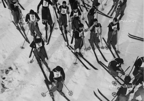 FVQ-F-119147-0000 - Fascist boys on the snow fields, during a break. Each of them has a number, as a sign of their partecipation in a competition.