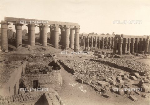 FVQ-F-121107-0000 - The ruins of the Temple of Luxor, Egypt. In the background, to the left is the grand entrance colonnade, called Amenhotep III, and at right, the courtyard of the festivals of Amenhotep III - Data dello scatto: 1870 - 1880 - Archivi Alinari, Firenze