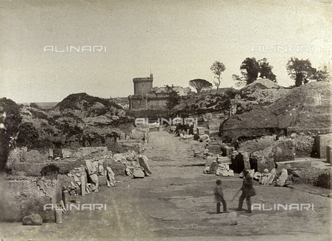 FVQ-F-141068-0000 - Numerous statues and finds along the edges of the Via Ostiense in Ostia Antica. In the background the Castle of Julius II can be glimpsed - Data dello scatto: 1855 ca. - Archivi Alinari, Firenze