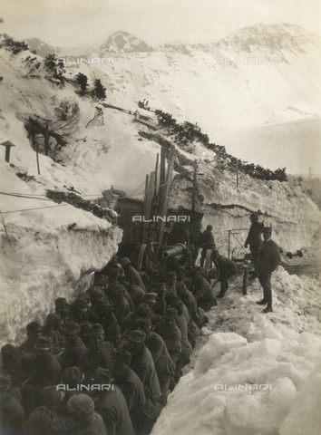 FVQ-F-178736-0000 - World War I: Soldiers in a trench in the snow pulling a gun