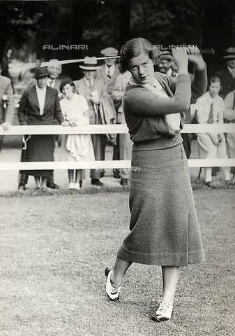 FVQ-F-193202-0000 - Miss Barton takes a shot during a golf tournament