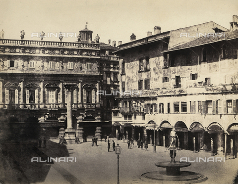 "FVQ-F-198525-0000 - Piazza della Erbe, Verona, delimited by the picturesque ""Houses of Mazzanti"", adorned with pictorial decorations from the sixteenth century In the background, the seventeenth century Palazzo Maffei and the Column of San Marco are visible - Data dello scatto: 1860 - Archivi Alinari, Firenze"