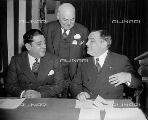 "GBB-F-002477-0000 - 1937, 15 november , WASHINGTON, USA : The United States Mayor of New York City FIORELLO LA GUARDIA (1882 - 1947).In spotlight at Mayors Conference Washington, D.C., Nov. 15. Mayor of Havana, Cuba, Antonio Beruff Mendieta (left) was welcomed to the Mayors Conference in the Capitol today be Fiorello La Guardia, (right) mayor of New York and president of the U.S. Conference of Mayors, and Mayor Angelo J. Rossi of San Francisco, Cal. Mayor Mandieta later addressed the conference on ""the first Pan-American Congress of Municipalities,"" - © ARCHIVIO GBB / Archivi Alinari"