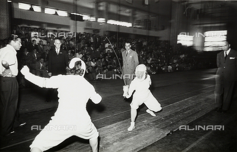 GCQ-A-003403-0016 - Fifth Centennial of the birth of Christopher Columbus - Colombiadi Sportive in Genoa: fencing match at the First International Women's Foil Team Tournament