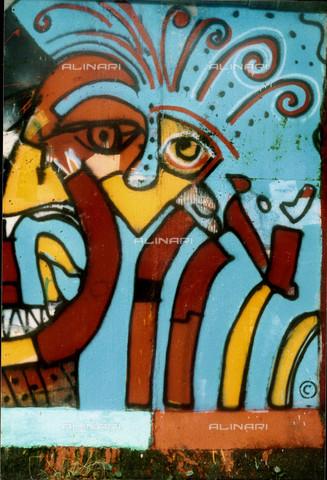 GRA-F-000025-0000 - Opera attribuibile a Christophe Bouchet. Graffiti & Wall Art sul Muro di Berlino, abbattuto a partire dalla notte del 9 Novembre del 1989 - Data dello scatto: 1987 - Gremese Archivio/Archivi Alinari, Francesco e Alessandro Alacevich