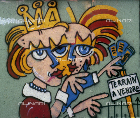 """GRA-F-000066-0000 - Two female figures and a cartel entitled """"Terrain a vendre"""" (Land for sale), Graffiti & Wall Art on the Berlin Wall that fell down beginning from the night of 9th November 1989 - Data dello scatto: 1987 - Francesco and Alessandro Alacevich / Gremese Archive/Alinari Archives"""