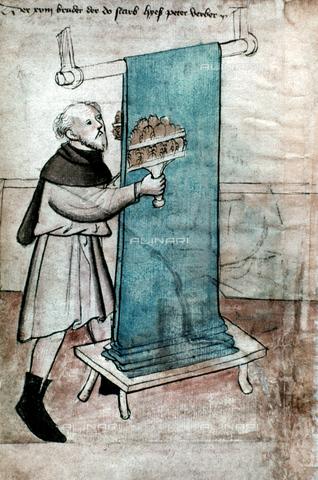 GRC-F-026775-0000 - Corporazione della lana: un lavoratore solleva le fibre di un tessuto di lana, miniatura, Arte tedesca del XIV sec. - Granger, NYC /Archivi Alinari