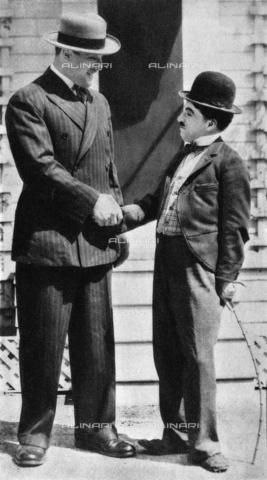 GRC-F-267270-0000 - Il campione di pugilato Primo Carnera (1906-1967) e l'attore comico Charlie Chaplin (1889-1977) - Data dello scatto: 1933 - Granger, NYC /Archivi Alinari