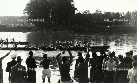 GRQ-F-006382-0000 - Crossing the finish-line at a rowing competition, the public applaudes
