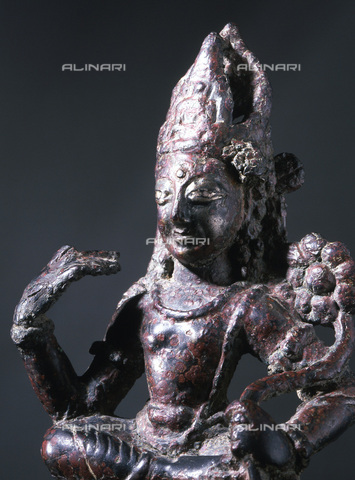 HIP-S-000233-0292 - Bronze statue of a Bodhisattva, possibly Padmapani, Swat Valley, north-west Pakistan, c8th century AD. Padmapani, the non-tantric form of Avalokiteshvara, is the creator of the world and all animate beings and the embodiment of compassion. Here he sits in 'lalila-sana' (royal ease) on a throne supported by two lions, symbols of Buddhism From the Theresa McCullough Collection, London - Werner Forman Archive / Heritage Images /Alinari Archives, Florence