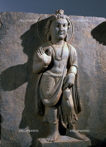 HIP-S-000233-0293 - Maitreya, detail from a frieze, Gandhara, north-west Pakistan, 2nd-3rd century. Depiction in grey schist of the 'Reassuring Maitreya'. The Buddha gestures in 'abhayamudra'. The Buddhist art of the Gandhara region is a unique fusion of Graeco-Roman and local styles. From the Theresa McCullough Collection, London - Werner Forman Archive / Heritage Images /Alinari Archives, Florence