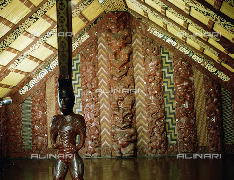 HIP-S-000233-0297 - Te Hau-Ki-Turanga meeting house, from Manutuke, New Zealand, 1842. Built by the Ngati Kaipoho tribe. The figural supporting pole is a representation of a specific founding ancestor identified by his distinctive moko tattoos, while the whole structure may be seen as an ancestral body, with the central ridge pole as the backbone. From the National Museum of New Zealand, Wellington - Werner Forman Archive / Heritage Images /Alinari Archives, Florence