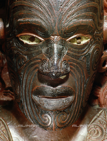 HIP-S-000233-0299 - Te Hau-Ki-Turanga meeting house, from Manutuke, New Zealand, 1842. Built by the Ngati Kaipoho tribe. Detail of the portrait figure of Raharuhi Rukupo, the chief responsible for organising and directing the carving. The unique arrangement of moko tattoos allowedthe subjects of portrait sculptures to be identified. From the National Museum of New Zealand, Wellington - Werner Forman Archive / Heritage Images /Alinari Archives, Florence