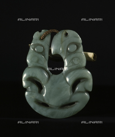 HIP-S-000233-0305 - Maori hei matau (fish hook) pendant made of jade, New Zealand, 19th century. The pendant was given by a Ngapuhi Maori chief to a British captain in 1834. It combines the fish hook shape with the tiki figure. The hei matau represents strength, good luck and safe travel over water. From the British Museum, London - Werner Forman Archive / Heritage Images /Alinari Archives, Florence