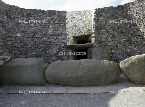 HIP-S-000233-0356 - Passage tomb, Newgrange, Boyne Valley, County Meath, Ireland, c3200 BC. The incised entrance stone in front of the mouth of the passage to the burial chamber. During the winter solstice ancestral cult ceremonies were performed in the chamber - Werner Forman Archive / Heritage Images /Alinari Archives, Florence
