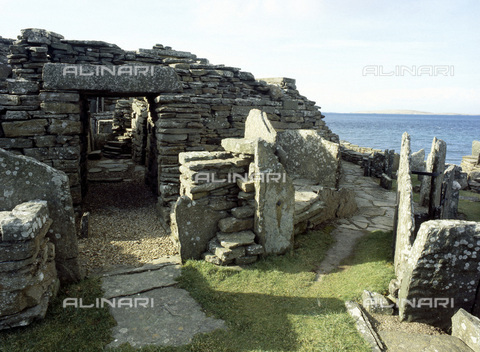 HIP-S-000233-0365 - The Broch of Gurness, Evie, Orkney, Scotland. Entrance view. The Broch of Gurness is thought to be an early Celtic Iron Age keep. It consists of a circular defensive wall built to protect a settlement. The fortification was about 8 metres tall and 20 metres across. It is thought to have been built between 200 BC and 100 AD - Werner Forman Archive / Heritage Images /Alinari Archives, Florence