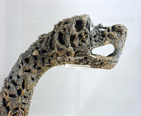 HIP-S-000233-0370 - Carved dragon-head post from the ship burial at Oseberg, Norway, Viking, c850. The oak ship, which was found in a large burial mound, was probably built in the early 9th century and buried in 834. It was excavated by Norwegian and Swedish archaeologists in 1904-1905. From the Viking Ship Museum, Bygdoy - Werner Forman Archive / Heritage Images /Alinari Archives, Florence
