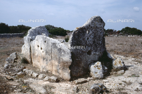 HIP-S-000233-0375 - Megalithic sepulchre at Ses Roques Llises, Torre d'en Gaumes, Minorca, Balearic Islands, Spain. One of the earliest examples of such architecture on the island, dating from Neolithic times - Werner Forman Archive/ N J Saunders / Heritage Images /Alinari Archives, Florence