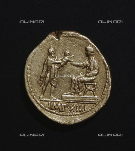 HIP-S-000233-0383 - Roman gold coin of Augustus, 27 BC - 14 AD. A Barbarian stands holding out a child to Augustus. From the British Museum, London - Werner Forman Archive / Heritage Images /Alinari Archives, Florence