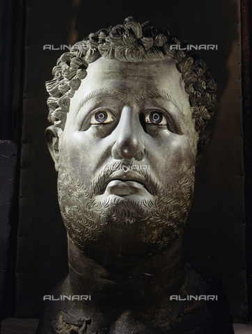 HIP-S-000233-0384 - Colossal bronze head of the Roman Emperor Hadrian, from Egypt, c130-131. Hadrian (ruled AD 117-138) visited Egypt in 130-131. The death of his lover Antinous by drowning in the Nile was commemorated by the founding of a new city, Antinopolis. From the Graeco-Roman Museum, Alexandria, Egypt - Werner Forman Archive / Heritage Images /Alinari Archives, Florence