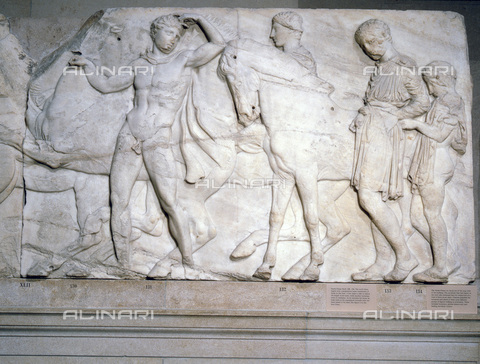 HIP-S-000233-0385 - Youths ready to mount (slab XLII), from the north frieze of the Parthenon, Greek, c438-432 BC. Designed by Phidias, the Parthenon frieze adorned the the temple of Athena on the Acropolis in Athens and represents a procession in honour of the Olympian gods. The majority of what survives of the frieze is today in either the British Museum or the Acropolis Museum in Athens. From the British Museum, London - Werner Forman Archive / Heritage Images /Alinari Archives, Florence