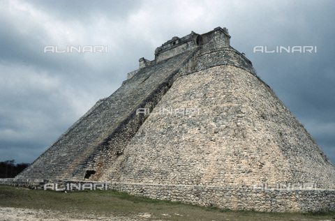 HIP-S-000235-6959 - The 'Pyramid of the Magician' at Uxmal, Yucatan, Mexico, Maya, 8th-11th century. Uxmal is one of the most well known of the Maya cities. Mayan chronicles say that it was founded in around 500 AD although most of the buildings visible today were built between 700 and 1100. The city was abandoned around 1450. The main buildings were the Pyramid of the Magician, the Nunnery Quadrangle, the Governor's Palace, the House of Turtles and the House of Pigeons. The Pyramid of the Magician was a temple. - Heritage Images /Alinari Archives, Florence, Werner Forman Archive/ N.J.Saunders