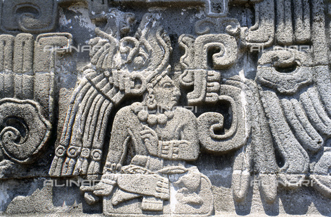 HIP-S-000235-6977 - Detail from the Toltec 'Temple of the Feathered Serpent', Xochicalco, Mexico, 700-900. A richly attired personage, so-called 9 Wind (the birthdate of the god Quetzalcoatl-Feathered Serpent). The style owes much to lowland Classic Maya representations of seated rulers - Heritage Images /Alinari Archives, Florence, Werner Forman Archive/ N.J.Saunders