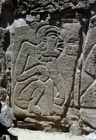 HIP-S-000235-6979 - Olmec style 'danzante' (dancer) figure on a stela, Zapotec/Mixtec, Oaxaca, Mexico. Danzante figure with 'speech glyph'. Originally thought to be dancers these reliefs are now interpreted as slain captives - Heritage Images /Alinari Archives, Florence, Werner Forman Archive/ N.J.Saunders