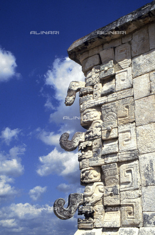 HIP-S-000235-6980 - Cornice of a building, ancient Mayan city of Uxmal, Yucatan, Mexico. Showing the distinctive snarling mouth and curled nose of the Maya god of rain, Chac. Uxmal is one of the most well known of the Maya cities. Mayan chronicles say that it was founded in around 500 AD although most of the buildings visible today were built between 700 and 1100. The city was abandoned around 1450 - Heritage Images /Alinari Archives, Florence, Werner Forman Archive/ N.J.Saunders