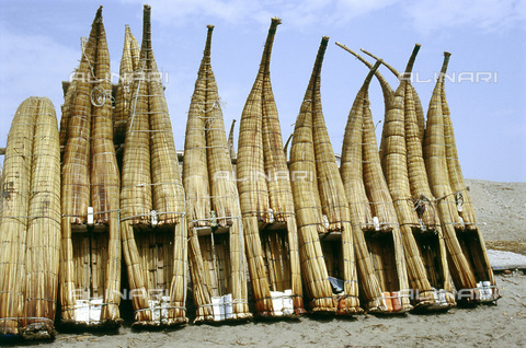 HIP-S-000235-6982 - Caballitos', traditional Peruvian reed boats, Lake Titicaca, Bolivia/Peru. A row of 'caballitos' (little horses), an ancient Peruvian type of boat made of totora reed. They are still used by the fishermen on the north coast of Peru and are depicted on Mochica pottery - Heritage Images /Alinari Archives, Florence, Werner Forman Archive/ N.J.Saunders