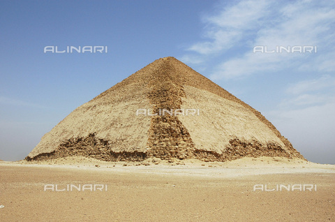 HIP-S-000236-2069 - The 'Bent Pyramid', Dahshur, Egypt, Ancient Egyptian, 4th dynasty, c2613-2589 BC. Built during the reign of the Pharaoh Sneferu it is considered to be the transitional form between the step-sided and smooth-sided pyramids. Most of its original casing is still intact - Heritage Images /Alinari Archives, Florence, Werner Forman Archive / N. J Saunders