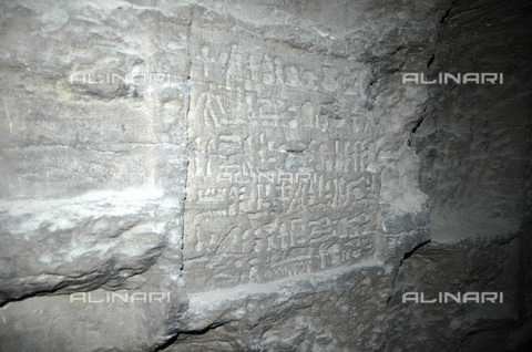 HIP-S-000236-2082 - Hieroglyphic inscription, the Serapeum, Saqqara, Egypt, c1213-30 BC.The Serapeum is a system of underground galleries hewn out of solid rock with large side chambers where the mummified remains of the sacred bulls of Apis were held in sarcophagi from the 13th century BC onwards. In Ptolemaic times the complex was dedicated to the god Serapis, who combined aspects of Osiris and Apis in Ptolemaic Egypt - Heritage Images /Alinari Archives, Florence, Werner Forman Archive / N. J Saunders