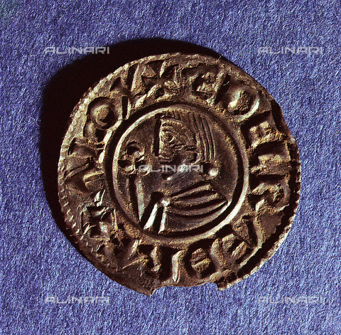 HIP-S-000256-8600 - Silver penny of Ethelred II (978-1016) CRVX (Crux) type with sceptre with trefoil head. This was the last among the English coins found in Scandinavian hoards. Country of Origin: England. Culture: Viking, c.991 - c.927. Material Size: Silver. British Museum, London - Werner Forman Archive / Heritage Images/Archivi Alinari, Firenze