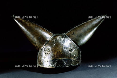 HIP-S-000256-8619 - Bronze helmet with two horns. Designed for either ceremonial use or as a votive offering. Found in the Thames. Country of Origin: Britain. Culture: Celtic, 1st C BC. British Museum, London - Werner Forman Archive / Heritage Images/Archivi Alinari, Firenze