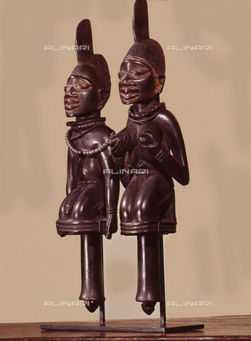 HIP-S-000256-9561 - Dance staffs depicting male and female devotees of Eshu, identifiable by the projection from their heads. Carried by cult followers in dances during which Eshu will enter their heads and induce possession. Country of Origin: Nigeria. Culture: Yoruba, 19th C. Material Size: Wood. Schindler Collection, New York - Werner Forman Archive / Heritage Images/Archivi Alinari, Firenze