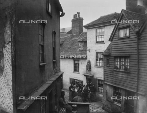 HIP-S-000266-7855 - George Lane, Rochester, Kent, 1862-1867. An elevated view showing a group of people outside the Old Parrs Head public house. Reproduced from a Gordon Barnes copy negative - Historic England Archive / Heritage Images /Alinari Archives, Florence
