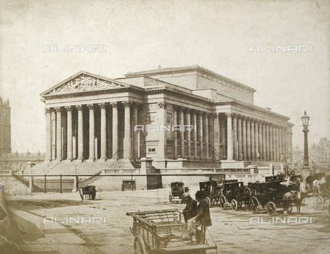HIP-S-000266-7860 - St George's Hall, St George's Plateau, Liverpool, 1854-1855. Salted paper print. Cabs stand outside the newly built neoclassical St George's Hall, designed by Harvey Lonsdale Elmes and completed by Charles Robert Cockerell. The building, combining a public hall and law courts, was erected between 1841 and 1856. The photograph is attributed to Thomas Sutton because the original mount bears the name of the Frenchman Louis-D#xe9;sir#xe9; Blanquart-Evrard, who published some of Sutton's negatives in 1854. Sutton and Blanquart-Evrard opened a printing establishment on Jersey in 1855, and launched the journal Photographic Notes the following year. Sutton was a prolific writer on photography, and published A Dictionary of Photography in 1858 - Historic England Archive / Heritage Images /Alinari Archives, Florence