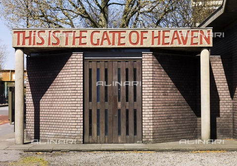 HIP-S-000266-7861 - Entrance of the Church of St Paul, Bow Common, Tower Hamlets, London, 2011. The church was designed by Robert Maguire and Keith Murray and built between 1956 and 1960, with lettering above the doors by Ralph Beyer: This is the House of God, This is the Gate of Heaven - Data dello scatto: 2011 - Historic England Archive / Heritage Images /Alinari Archives, Florence