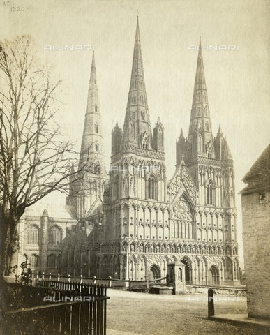 HIP-S-000266-7874 - Lichfield Cathedral, Staffordshire, c1860. Albumen print. Francis Bedford's photograph, published by Thompson amp; Co, shows the west front of Lichfield Cathedral. General views of cathedrals and photographs of their architectural details had been popular subjects for pioneer photographers, and they continued to attract attention as the mass market in photography developed. Lichfield Cathedral, one of the smallest in England, had been severely damaged during the Civil War. Significant restoration had been undertaken in the 17th and 18th centuries, and Bedford's view was taken before the west window (between the towers) was remodelled in the late 1860s during Sir George Gilbert Scott's restoration of 1856-1878 - Historic England Archive / Heritage Images /Alinari Archives, Florence