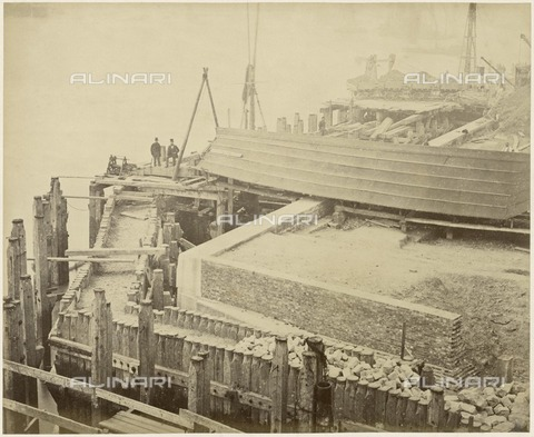HIP-S-000267-2793 - Construction of the expanded Limehouse Basin, London, May 1869. View showing details of the work. The pentice structure may be sheltering a chute delivering concrete to the basin wall - Historic England Archive / Heritage Images /Alinari Archives, Florence