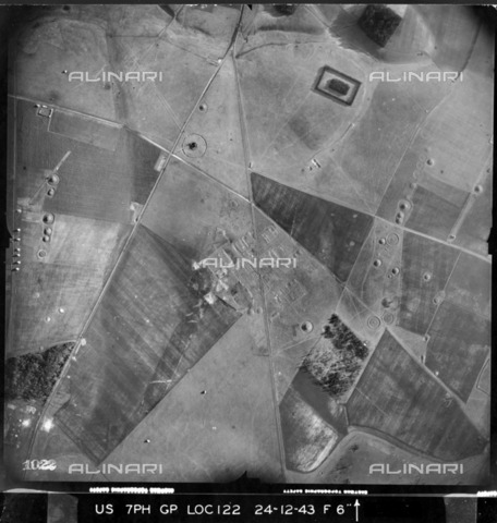 HIP-S-000267-2815 - The Stonehenge landscape on Christmas Eve 1943, with groups of round barrows visible. Remains of a First World War military camp can also be seen in the centre of the picture - Historic England Archive / Heritage Images /Alinari Archives, Florence