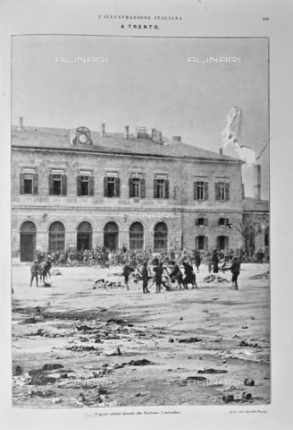 """IIB-S-091845-0419 - The soldiers of the Italian army in front of Trento station on November 3, 1918, the date of the signature of the armistice between the Austro-Hungarian Empire and Italy, allied with the Triple Intesa (the United Kingdom, France and Russia) ; the agreement ensured the annexation of Trento and Trieste to the Kingdom of Italy; engraving. Photography taken from the magazine """"The Italian Illustration"""" of November 10, 1918, no. 45, page 419 - Date of photography: 03/11/1918 - Library of Fratelli Alinari Museum of the History of Photography, Florence"""
